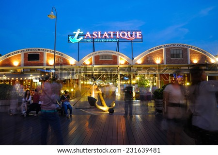 BANGKOK - MAY 1: Unidentified people visit Asiatique The Riverfront at night on May 1, 2014 in Bangkok, Thailand. Asiatique The Riverfront is a popular night attraction housing more than 500 shops.