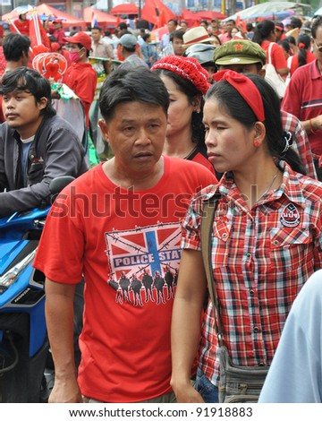 BANGKOK - MAY 19: Unidentified red-shirt protesters gather at Ratchaprasong Junction to mark a year since 91 people died in violent anti-government clashes in the Thai capital on May 19, 2011 in Bangkok, Thailand. - stock photo