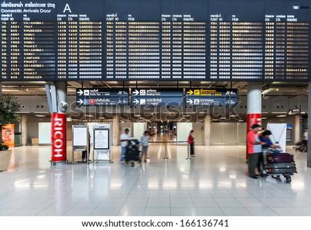 BANGKOK - NOV 8: a departures board at Suvarnabhumi International Airport on Nov 8, 2013 in Bangkok, Thailand. The airport handles 45 million passengers annually. - stock photo