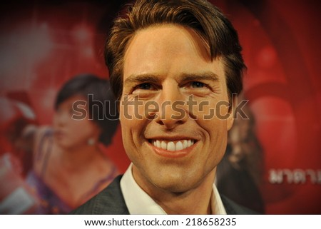 BANGKOK - NOV 21: A waxwork of Tom Cruise on display at the newly opened Madam Tussauds on Nov 21, 2013. Madam Tussauds' newest branch hosts waxworks of numerous stars and celebrities. - stock photo