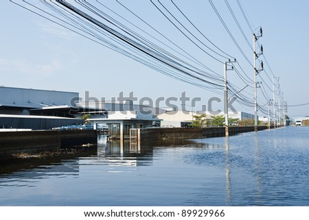 BANGKOK - NOV. 25: Factories damaged at Nava Nakorn Industrial, which is flooded for a period of 1 month on November 25, 2011 at Nava Nakorn Industrial Pathum Thani in Bangkok.