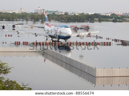 BANGKOK-NOV 8:Flood hits Bangkok areas around Donmaung Airport, higher water levels than expected,aircraft affected by flood on November 8, 2011, Bangkok - stock photo