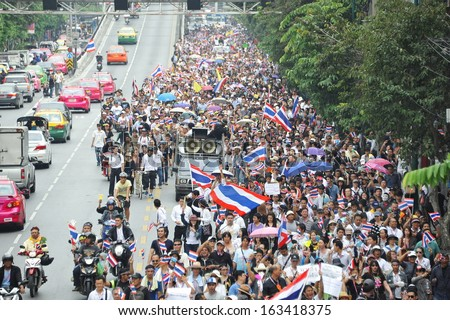 BANGKOK - NOV 11: Protesters march through the Thai capital to join a large anti-government rally on Nov 11, 2013 in Bangkok, Thailand. The protesters call for the government to be overthrown.