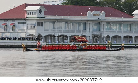 BANGKOK - NOV 9: Traditional Thai rowing boats make their way to Wat Arun on the Chao Phraya River while taking part in the Royal Barge Procession on Nov 9, 2012 in Bangkok, Thailand. - stock photo