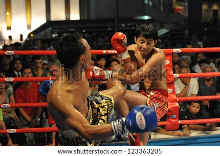 BANGKOK - NOV 21: Unidentified Muay Thai fighters compete in an amateur Thai kickboxing, or Muay Thai, match at MBK Fight Night on Nov 21, 2012 in Bangkok, Thailand. - stock photo