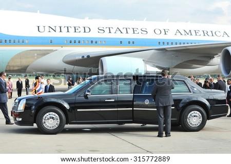 BANGKOK - NOV 18: US Presidential State Car waits by Air Force One on tarmac at Don Muang International Airport as President Barack Obama begins his SE Asia tour on Nov 18, 2012 in Bangkok, Thailand. - stock photo