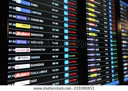 BANGKOK - NOV 12: View of a departures board at Suvarnabhumi International Airport on Nov 12, 2011 in Bangkok, Thailand. The SE Asia aviation hub handles 45 million passengers annually.  - stock photo