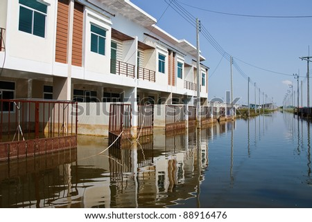 BANGKOK - NOVEMBER 16: flooded city on November 16, 2011 at Pathum Thani, Bangkok, which is the worst flood in the history of Thailand. - stock photo