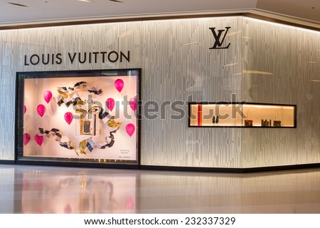 BANGKOK - NOVEMBER 18, 2014 : Louis Vuitton store in Siam Paragon Mall in Bangkok, Thailand. Opened in July 2012, this is LV's 4th store in Bangkok. - stock photo