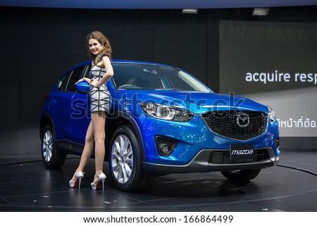 BANGKOK - NOVEMBER 28 : Mazda CX-5 Skyactiv on display at The 30th Thailand International Motor Expo 2013 in Bangkok, Thailand. - stock photo