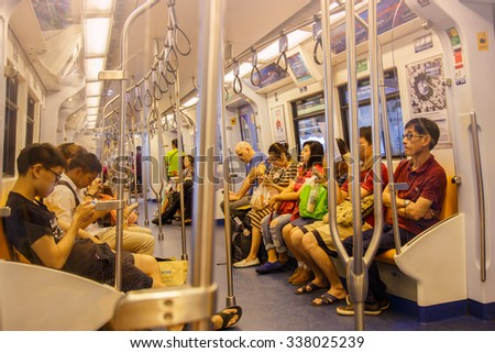 BANGKOK - NOVEMBER 8: People ride in BTS Skytrain on November 8, 2015 in Bangkok, Thailand. The service carried an average 600,000 passengers per day in 2012. - stock photo