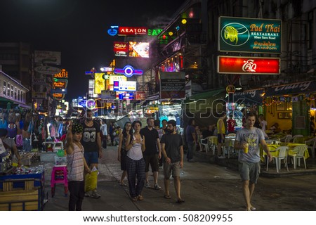BANGKOK - NOVEMBER 17, 2014: Tourists, vendors, and touts share the pedestrianized street on a typical night in the backpacker nightlife center of Khao San Road.