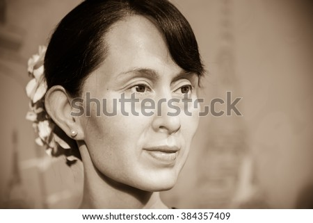 BANGKOK - OCT 28: A waxwork of Aung San Suu Kyi on display at Madame Tussauds on October 28, 2015 in Bangkok, Thailand. Madame Tussauds' newest branch hosts waxworks of numerous stars and celebrities.