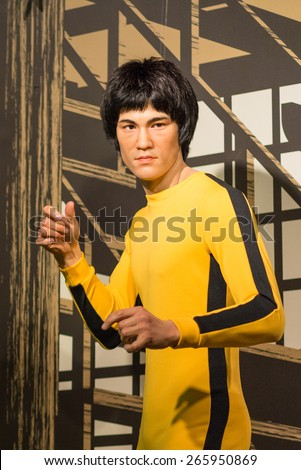 BANGKOK - OCT 21: A waxwork of Bruce Lee on display at Madame Tussauds on Oct 21, 2012 in Bangkok, Thailand. Madame Tussauds' newest branch hosts waxworks of numerous stars and celebrities. - stock photo