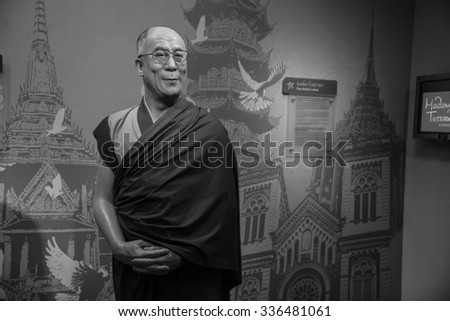 BANGKOK - OCT 28: A waxwork of The Dalai Lama on display at Madame Tussauds on October 28, 2015 in Bangkok, Thailand. Madame Tussauds' newest branch hosts waxworks of numerous stars and celebrities.