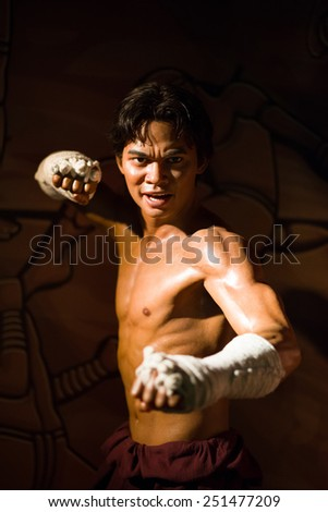 BANGKOK - OCT 21: A waxwork of Tony Jaa on display at Madame Tussauds on Oct 21, 2012 in Bangkok, Thailand. Madame Tussauds' newest branch hosts waxworks of numerous stars and celebrities. - stock photo