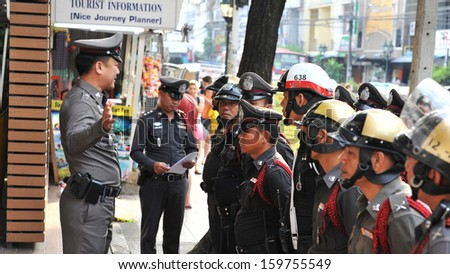 BANGKOK - OCT 31: Police are briefed at a station on Khao San Road before Halloween festivites on Oct 31, 2012 in Bangkok, Thailand. The Khao San Halloween party is popular with tourists and locals. - stock photo