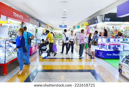 BANGKOK - OCT 9: Shoppers visits MBK Center on Oct 9, 2014 in Bangkok, Thailand. MBK is one of the oldest malls in SE Asia and is currently home to over 2000 retail outlets and services.  - stock photo