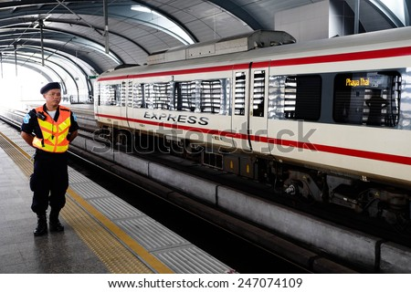 BANGKOK - October 17:  Security guard on an empty metro (MRT) station on October 17, 2014 in Bangkok, Thailand. The MRT serves more than 240,000 passengers each day. - stock photo