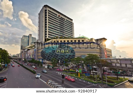 BANGKOK - OCTOBER 2: traffic at junction of the MBK shopping mall in Bangkok, Thailand as seen on October 2, 2011.Over 100,000 people visit daily,make it one of the most popular spots in Bangkok. - stock photo