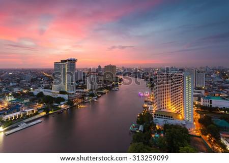 Bangkok river view at Dusk with modern business building along the Chao Phraya river (Thailand) - stock photo
