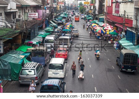 BANGKOK - SEP 6: View of a busy street in Chinatown on Sep 6, 2013 in Bangkok, Thailand. Bangkok's Chinatown is a popular tourist attraction and a food haven. - stock photo