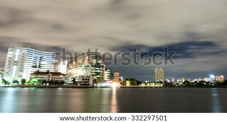 BANGKOK - SEPTEMBER 5: Buildings of Siriraj hospital was along Chaophraya river, in twilight cloudy evening night light view, in Bangkok, Thailand, was taken on September 5, 2015.
