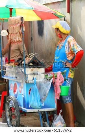 BANGKOK- SEPTEMBER 13: Thai people sell food by the road on September 13, 2010 in Bangkok, Thailand. - stock photo