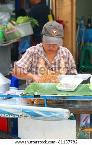 BANGKOK- SEPTEMBER 13:Thai people sell food by the road on September 13, 2010 in Bangkok, Thailand. - stock photo