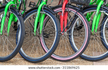 BANGKOK - SEPTEMBER,1 : The bicycle wheel in close up park at the public park of the main city. Now there are many people love to exercise by bicycle. THAILAND SEPTEMBER,1 2015 - stock photo