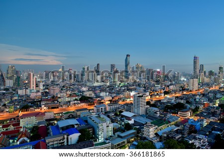 Bangkok Skyline at Dusk View from High Rise Building, top of Bangkok at twilight - stock photo
