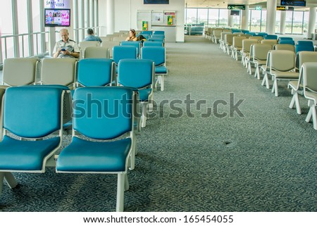 BANGKOK,THAIILAND-OCTOBER 12:People in waiting room at Don Mueang international airport on October 12,2013 in Bangkok,Thailand.Don Mueang airport It is one of the world oldest international airports.