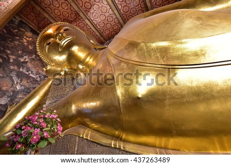 BANGKOK - THAILAND / 01.12.2015: A reclining Buddha is a statue that represents Buddha lying down and is a major iconographic and statuary pattern of Buddhism - stock photo