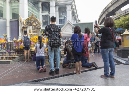 BANGKOK,THAILAND - APR 17 : group of tourist worship in Erawan shrine at Ratchaprasong Junction on april 17, 2016, Thailand. Erawan shrine is one of famously sacred item in Ratchaprasong area
