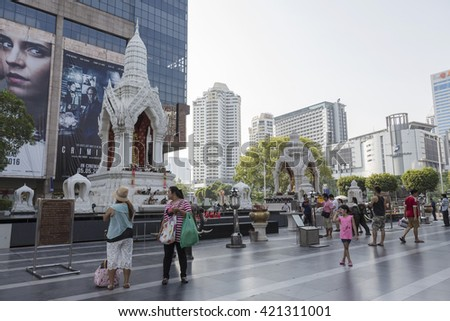 BANGKOK, THAILAND - APR 17 : Unidentified people pray to Trimurati shrine at Central world in Ratchaprasong on april 17, 2016. Thailand. Trimurati shrine is one of sacred item in Ratchaprasong area
