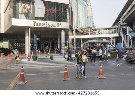 BANGKOK THAILAND - APR 29 : unidentified people walk across crosswalk near  terminal 21 shopping mall at Asoke in sukhumvit road on april, 29, 2016, thailand. - stock photo