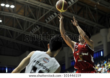BANGKOK, THAILAND - APR 22 : Unidentified player in action at Asean Basketball League 2012 (ABL) between Slammers vs San Miguel at Thai Japanese Association Gym on April 22, 2012 in Bangkok, Thailand