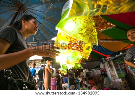 BANGKOK, THAILAND - APR 24: Unidentified seller in fishmarket at Chatuchak Apr 24, 2012 in Bangkok, Thailand. Chatuchak is one of the world's largest markets covering over 35 acres with 15,000 stalls.