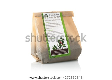 BANGKOK, THAILAND - APRIL 25, 2015: A bag of coffee grounds with Thai instructions free offer from Starbucks coffee shop in Thailand. Starbucks is the world's largest coffee house. - stock photo