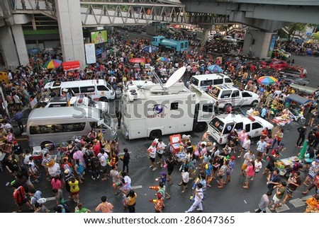 BANGKOK, THAILAND - APRIL 14: A streetscape view of crowds of people celebrating Songkran with water everywhere on Silom Road, Bangkok, Thailand on the 14th April, 2015.
