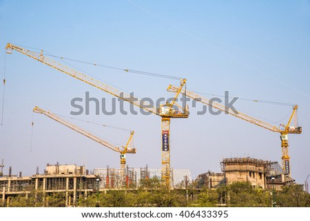 Bangkok, Thailand- APRIL12, 2016 : Abstract building background with construction cranes with blue sky. View from Sanam Luang