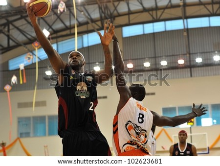 BANGKOK, THAILAND - APRIL 15 : An unidentified player in action at  Asean Basketball League 2012 (ABL) between Cobras vs Slammers at CU sport complex on April 15, 2012 in Bangkok, Thailand