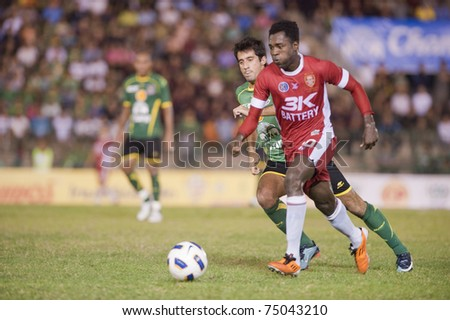 BANGKOK THAILAND- APRIL 9 :B.Ajuwa (red) in Thai Premier League (TPL) between Army Utd. (green) vs BEC Tero Fc (red) onApril 9, 2011 at Army Stadium in Bangkok Thailand