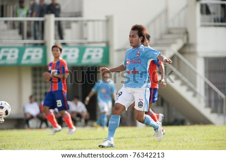 BANGKOK THAILAND- APRIL 30 : C.Nilsang(blue) in action during Thai Premier League (TPL) between thai port fc (Orange) vs SCG Samutsongkram (Blue) on April 30, 2011 at PAT Stadium in Bangkok Thailand