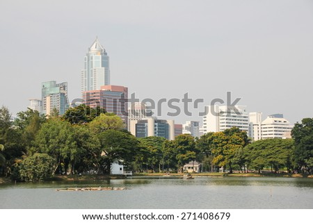 BANGKOK, THAILAND - APRIL 7,2015 : Cityscape from Lumpini Park in the business district on APRIL 7, 2015 in Bangkok, Thailand. Lumpini Park is the big park in center of Bangkok covers 142 acres.