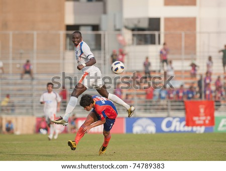 BANGKOK THAILAND- APRIL 6 :K.Mohamed (White) in Thai Premier League (TPL) between thai port fc (Orange) vs TOT  SC (green)   on April 6, 2011 at PAT Stadium in Bangkok Thailand