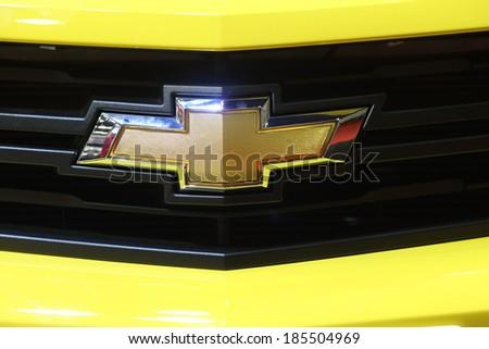 BANGKOK THAILAND-APRIL 4 : Logo of Chevrolet on yellow Camaro displayed on stage at The 35th Bangkok International Motor Show 2014 on April 4, 2014 in Bangkok, Thailand. - stock photo