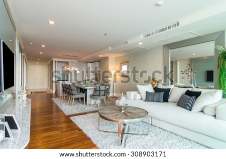 BANGKOK, THAILAND - APRIL 25 :  Luxury Interior living room with kitchen zone and restaurant set at My resort as river condominium beside the chao phraya river on April 25, 2015 in Bangkok, Thailand - stock photo