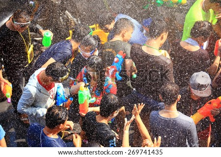 BANGKOK, THAILAND - APRIL 14, 2015: people playing water in Songkran festival on April 14, 2015 at Silom Road in Bangkok. Celebration of Thai New Year (Songkran water festival) in 2015.