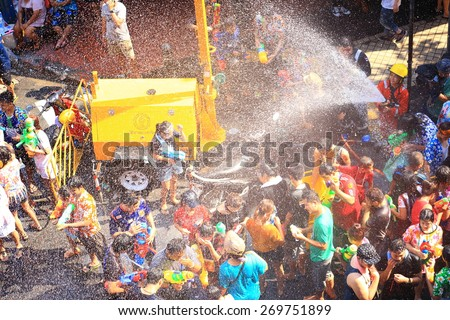 BANGKOK, THAILAND - APRIL 14, 2015: people playing water in Songkran festival on April 14, 2015 at Silom Road in Bangkok. - stock photo
